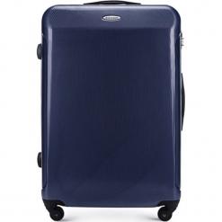 Walizka w kolorze niebieskim - 89 l. Niebieskie walizki Wittchen, z materiału. W wyprzedaży za 269,95 zł.