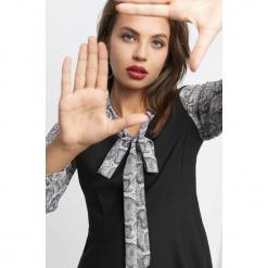 Sukienka wiązana przy dekolcie. Czarne sukienki balowe marki Orsay, xs, z bawełny, z dekoltem na plecach. W wyprzedaży za 100,00 zł.