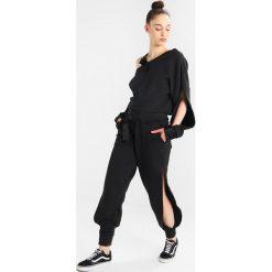 Spodnie sportowe damskie: Ivy Park HARNESSED JOGGERS Spodnie treningowe black