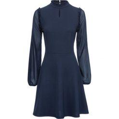 Sukienka z dżerseju z szyfonowymi rękawami bonprix ciemnoniebieski. Niebieskie sukienki z falbanami marki bonprix, z dżerseju. Za 129,99 zł.