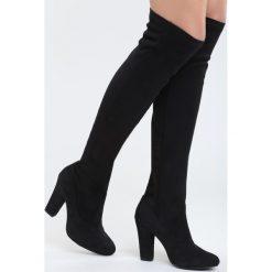 Czarne Kozaki Russian Roulette. Czarne buty zimowe damskie marki Superfit, z gore-texu, przed kolano, na wysokim obcasie. Za 89,99 zł.