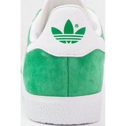 Adidas Originals GAZELLE Tenisówki i Trampki green/white/gold metallic. Zielone tenisówki męskie marki adidas Originals, z materiału. Za 399,00 zł.