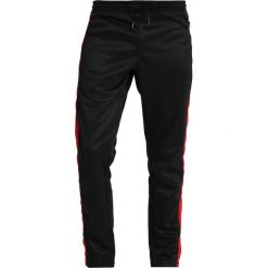 Jeansy męskie regular: Tiger of Sweden Jeans MARLY Spodnie treningowe black
