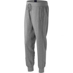 New Balance WP53502AG. Szare spodnie dresowe damskie New Balance, z bawełny. Za 99,99 zł.