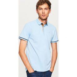 Koszulka polo - Niebieski. Niebieskie koszulki polo Reserved, l. Za 79,99 zł.