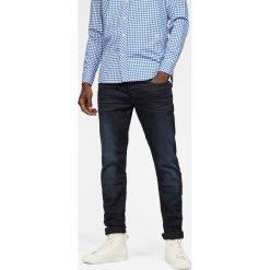 G-Star Raw - Jeansy 3301 slim. Niebieskie jeansy męskie regular G-Star RAW, z aplikacjami, z bawełny. W wyprzedaży za 439,90 zł.