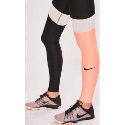 Nike Sportswear - Legginsy. Szare legginsy skórzane Nike Sportswear, l. Za 199,90 zł.