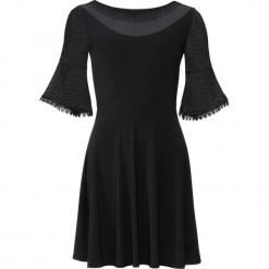 Sukienka z siatkowymi wstawkami bonprix czarny. Czarne sukienki koronkowe bonprix, na imprezę, w koronkowe wzory. Za 99,99 zł.