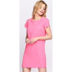 Różowa Sukienka The Bridge. Różowe sukienki letnie marki numoco, l, z dekoltem w łódkę, oversize. Za 59,99 zł.