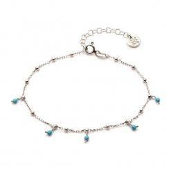 Srebrna bransoletka z turkusami. Niebieskie bransoletki damskie z cyrkoniami Ania Kruk, srebrne. W wyprzedaży za 72,95 zł.