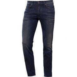 DRYKORN JAW  Jeansy Slim Fit blue. Niebieskie jeansy męskie relaxed fit marki DRYKORN, z bawełny. W wyprzedaży za 503,20 zł.