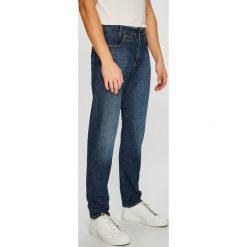G-Star Raw - Jeansy D-Staq. Niebieskie jeansy męskie z dziurami marki G-Star RAW. W wyprzedaży za 549,90 zł.