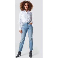 Levi's Jeansy 501 Crop - Blue. Niebieskie spodnie z wysokim stanem Levi's®, z jeansu. Za 404,95 zł.