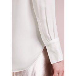 Polo Ralph Lauren Bluzka trophy cream. Szare bluzki asymetryczne Polo Ralph Lauren, xs, z jedwabiu, polo. Za 839,00 zł.