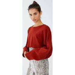Krótka bluza ze 100% bawełny. Czerwone bluzy damskie marki KALENJI, z elastanu, z krótkim rękawem, krótkie. Za 79,90 zł.