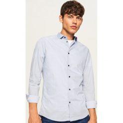 Koszula z mikroprintem regular fit - Niebieski. Niebieskie koszule męskie marki Reserved, l. Za 89,99 zł.
