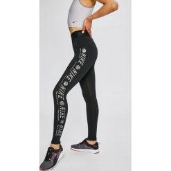 Nike Sportswear - Legginsy. Różowe legginsy marki Nike Sportswear, l, z nylonu, z okrągłym kołnierzem. W wyprzedaży za 139,90 zł.