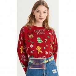 Bluza ze świątecznym nadrukiem all over - Czerwony. Czerwone bluzy z nadrukiem damskie Sinsay, l. Za 49,99 zł.