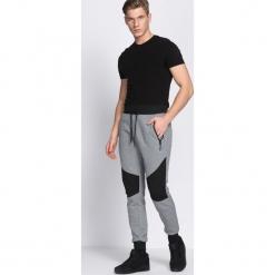 Szare Spodnie Dresowe In Existence. Czarne spodnie dresowe męskie marki Born2be, l, z aplikacjami, z dresówki. Za 49,99 zł.