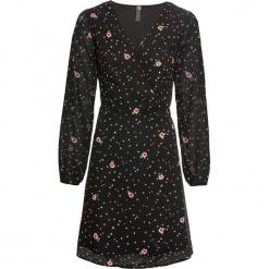 Sukienka kopertowa bonprix czarny z nadrukiem. Czarne sukienki z falbanami marki bonprix, w kropki, z kopertowym dekoltem, kopertowe. Za 99,99 zł.