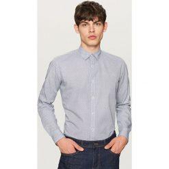 Koszula z podwijanymi rękawami slim fit - Granatowy. Niebieskie koszule męskie slim marki QUECHUA, m, z elastanu. W wyprzedaży za 59,99 zł.