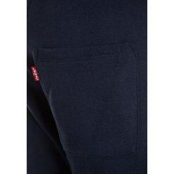 Levi's® BERMUDA Spodnie treningowe blue. Brązowe spodnie chłopięce marki Levi's®, z bawełny. Za 149,00 zł.