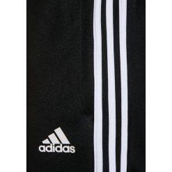 Adidas Performance TIRO Spodnie treningowe black/white. Czarne spodnie chłopięce adidas Performance, z materiału. W wyprzedaży za 135,20 zł.