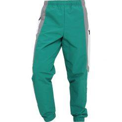 Adidas Originals WIND PANT Spodnie treningowe subgreen. Szare spodnie dresowe męskie marki adidas Originals, l, z nadrukiem, z bawełny, z kapturem. Za 379,00 zł.