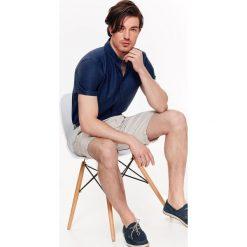 KOSZULA MĘSKA Z TKANINY OXFORD O KROJU REGULAR. Brązowe koszule męskie marki QUECHUA, m, z elastanu, z krótkim rękawem. Za 39,99 zł.