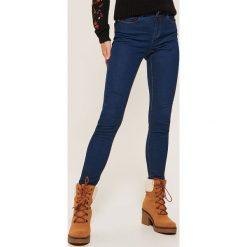Jeansy skinny - Granatowy. Czarne jeansy męskie skinny marki KIPSTA, z poliesteru, do piłki nożnej. Za 99,99 zł.