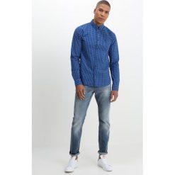 Scotch & Soda RALSTON  Jeansy Slim Fit dutch skies. Niebieskie jeansy męskie relaxed fit Scotch & Soda, z bawełny. W wyprzedaży za 356,85 zł.