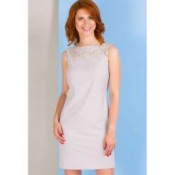 Odzież damska: Sukienka z ozdobną koronką