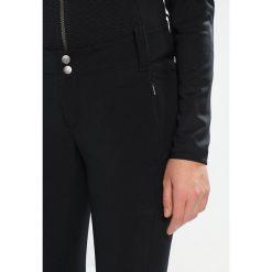 Columbia ROFFE RIDGE Spodnie narciarskie black. Czarne bryczesy damskie Columbia, z elastanu, narciarskie. Za 399,00 zł.