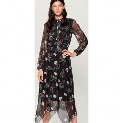Sukienka z kwiatowym wzorem all over - Czarny. Czarne sukienki z falbanami marki Mohito, l. Za 169,99 zł.