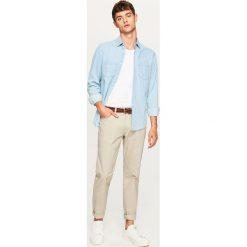 Jeansowa koszula slim fit - Niebieski. Niebieskie koszule męskie jeansowe marki Reserved, m. Za 119,99 zł.