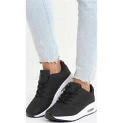 Czarne Buty Sportowe Hot Days. Czarne buty sportowe damskie marki DOMYOS, z bawełny. Za 79,99 zł.