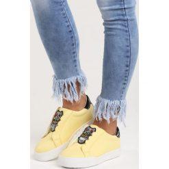 Żółte Buty Sportowe Milion Lights. Żółte buty sportowe damskie marki NEWFEEL, z gumy. Za 79,99 zł.