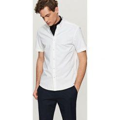 Gładka koszula slim fit - Biały. Białe koszule męskie slim marki INESIS, m, z bawełny, z długim rękawem. Za 119,99 zł.