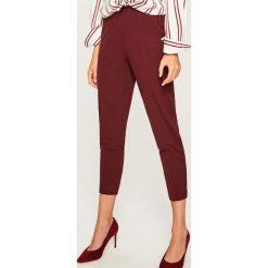 Spodnie z wysokim stanem - Bordowy. Czerwone spodnie z wysokim stanem Reserved. Za 49,99 zł.