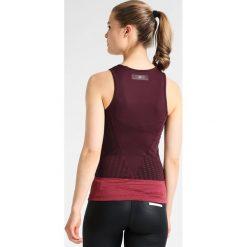 Adidas by Stella McCartney TRAIN Koszulka sportowa bordeaux. Czerwone t-shirty damskie adidas by Stella McCartney, xs, z elastanu. W wyprzedaży za 164,45 zł.
