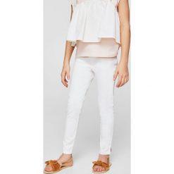 Mango Kids - Spodnie dziecięce Poly2 110-164 cm. Fioletowe rurki dziewczęce marki OLAIAN, z elastanu, sportowe. W wyprzedaży za 49,90 zł.