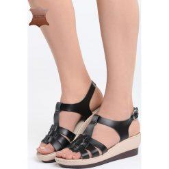 Czarne Skórzane Sandały Creature Comforts. Czarne sandały damskie marki Born2be, z materiału, na koturnie. Za 99,99 zł.