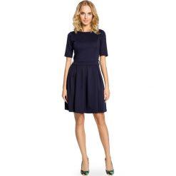 CHRISTINA Elegancka sukienka z kontrafałdą - granatowa. Niebieskie sukienki balowe marki numoco, na imprezę, s, w kwiaty, z jeansu, sportowe. Za 119,00 zł.