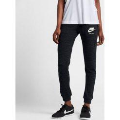 Spodnie Nike Wmns NSW Gym Vintage Pant (883731-010). Czarne bryczesy damskie marki Alpha Industries, z materiału. Za 139,99 zł.