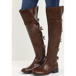 Brązowe Kozaki Underneath It All. Brązowe buty zimowe damskie marki Born2be, z materiału, z okrągłym noskiem, na obcasie. Za 109,99 zł.