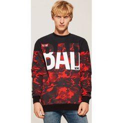 Bluza z napisem Bad - Czerwony. Czerwone bluzy męskie rozpinane House, l, z napisami. Za 79,99 zł.
