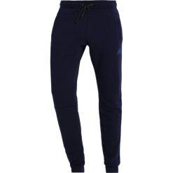 Spodnie dresowe męskie: New Balance ATHLETICS Spodnie treningowe pigment