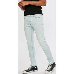 Lacoste - Jeansy. Niebieskie rurki męskie Lacoste, z bawełny. W wyprzedaży za 269,90 zł.