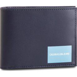 Duży Portfel Męski CALVIN KLEIN JEANS - Coated Canvas Billfold W Coin K40K400836 449. Niebieskie portfele męskie marki Calvin Klein Jeans, z jeansu. Za 279,00 zł.