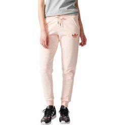 Spodnie sportowe damskie: Adidas Spodnie Slim Trackpant beżowe r. L (S19745)